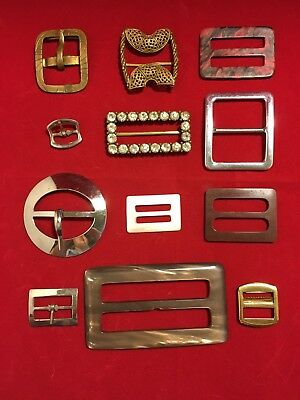 collection of vintage belt buckles clothing