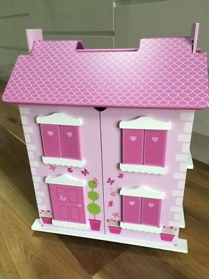 Girls painted wooden double story dollhouse with furniture. As new. RRP $59