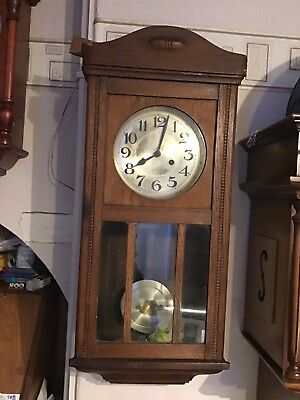 A Vintage German Striking Wall Clock