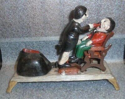 old Dentist cast iron mechanical bank