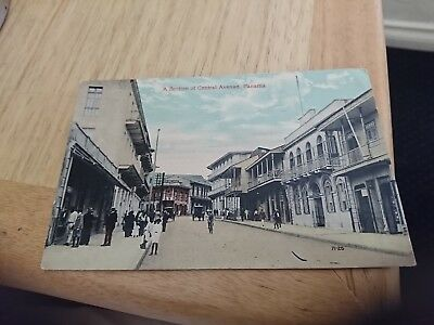 Early 1900s real photo postcard Panama street shops  people