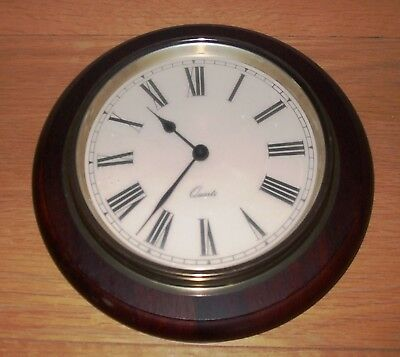 Quartz wall clock with a brass and wooden surround, 27cm diameter, working order