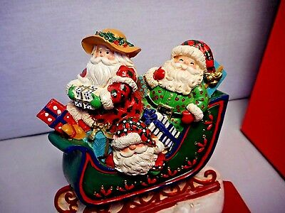 vintage 1994  cast iron hand painted Santas  in sleigh adjustable hook  box