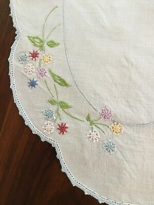 Vintage linen embroidered table centrepiece doily Measures 45x30cms.pinhole