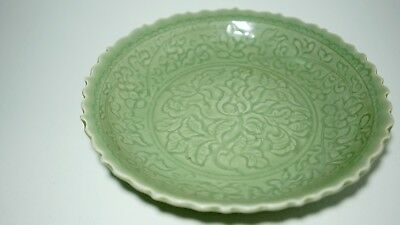 A Large Carved 'Peony' Longquan Celadon Barbed-Rim Charger