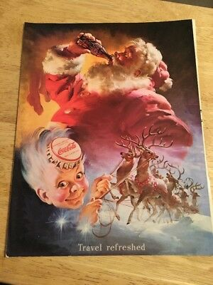 1990s Reproduction of a Vintage COCA-COLA  AD  Travel Refreshed Santa Claus