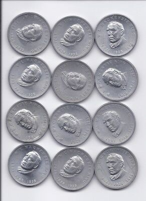 Lot of 12 W.L. Mackenzie King - 1921-1926-1935 Shell Canada Tokens