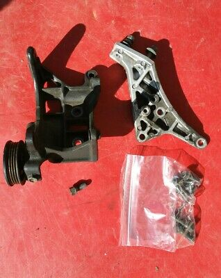 GEO CHEVY METRO 89-94  3CYL  ENGINE MOUNT BRACKET/A/C Mount and pulley tensioner