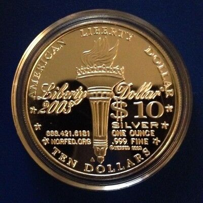 2003 NORFED .999 fine 1 oz Silver Liberty Rounds - $10 in airtite capsule