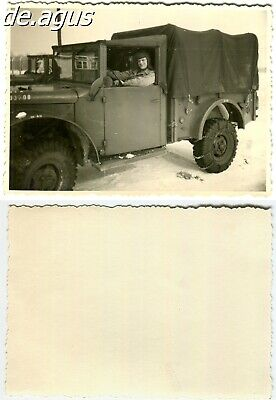 Vintage Photo 1950s young man sitting on us military truck
