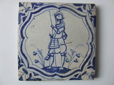 Dutch Delft tile with a Spanish Soldier in Accolade frame.
