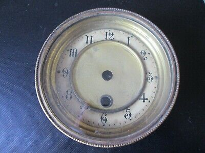 A Small Brass Mantel Clock Bezel With A Celluloid Chapter Ring Insert Type