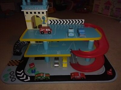 Wooden Play Garage with assorted wooden vehicles