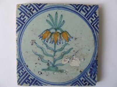 """A Dutch Delft tile with a """"Imperial"""" Flower in Polychrome."""