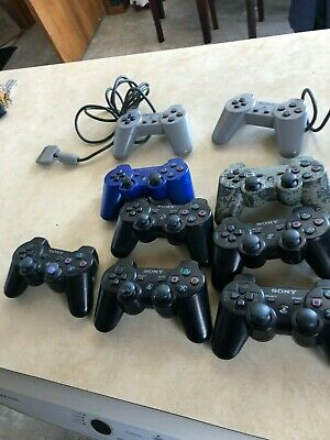 Lot of (9) Original Sony PlayStation Wireless Controllers, BLACK blue camo