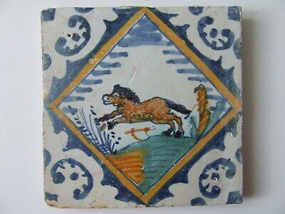 Dutch Delft Polychrome tile with Jumping Horse in Quedrant end 16th C.