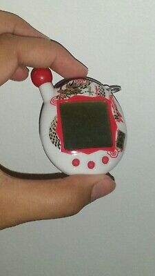 Tamagotchi Bandai 2004- Pre Owned- White and Red