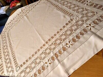 Four vintage white lace edged or embroidered table cloths