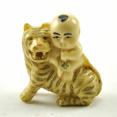 Old Chinese/ Japanese Happy Lucky Baby Boy riding Tiger Resin NETSUKE NEW 1.75""