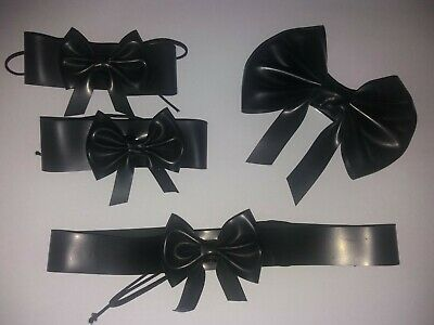 black latex rubber dress up set with collar, cuffs and bow clip.