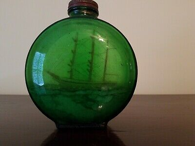 Antique clipper ship in a bottle from the 1920's.  Maritime history.