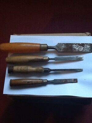 A Group Of 4 Woodworking Chisels