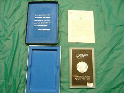 1883-CC Morgan silver dollar in boxed case with numbered certificate