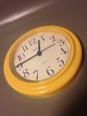 Mid century vintage wall clock in yellow and blue by Westclox vintage