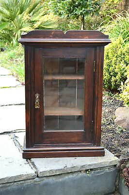 Small antique Edwardian oak cabinet with glazed door with key circa.1900-10