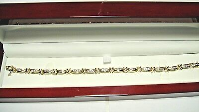 14k. yellow gold, 42 round brilliant cut diamond tennis bracelet. 1.00cttw.