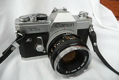 Vintage Canon TL QL SLR  Film Camera with a Canon FD 50 mm f/1.8 lens, student