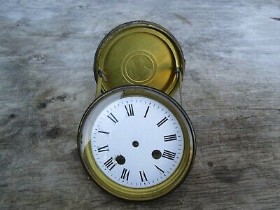 A French Striking Mantel Clock Bezel With Glass Dial Rear Door And Straps