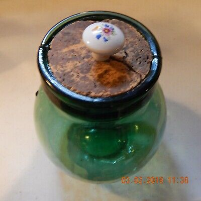 Vintage Viresa green glass bottle/jar. Has bubbles in the glass