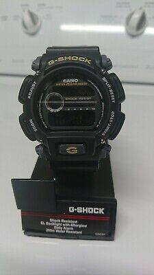 Casio Men's DW9052-1CCG G-Shock Digital Gold-Tone Accents Black Resin 47mm Watch