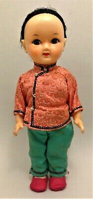 Vintage Chinese rubber doll with original outfit 25 cm height
