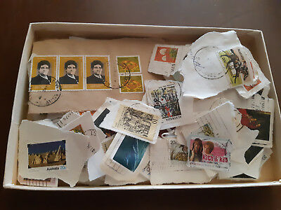 Box of used decimal Australian stamps, on paper
