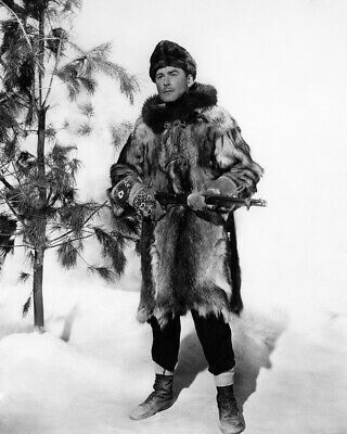 Northern Pursuit Errol Flynn full length pose fur coat & hat in snow 8X10 Photo