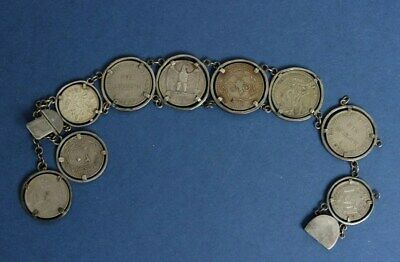Great Britain / Middle East Silver & CuNi Coin Bracelet. Silver surrounds, 68g