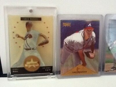 Greg Maddux 4 card lot including collector's choice gold signature