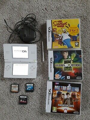 nintendo ds lite white  console, nintendo charger and 6 games good condition