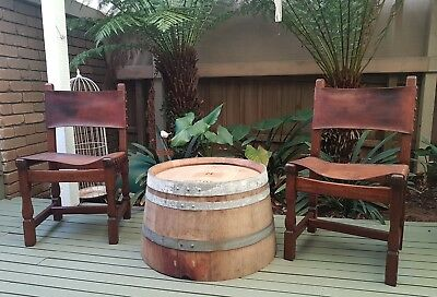 2 vintage leather sling back chairs