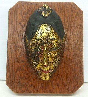 Antique Thailand Parcel Gilt Gold Wood Mask Mounted to Wood Plaque