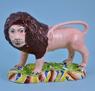 Unusual Antique Staffordshire pottery Lion with 'Human' face, circa 1825