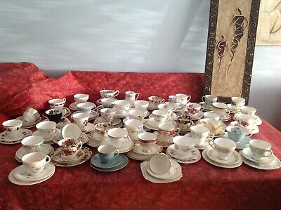 An assortment of vintage china tea cup trios