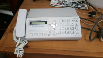 Sharp home phone with fax machine.