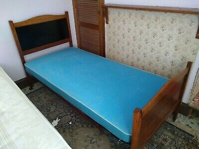 Antique Vono bed. Oak head and foot boards with steel frame. Mattress included.