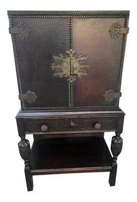 A Jacobean Style Brass Mounted Cabinet Oak with Leather Top