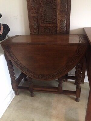 Vintage oak drop-leaf table with barley twist legs and table-top design