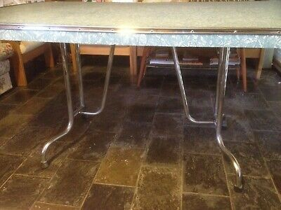 $350 Retro vintage 1950s laminated kitchen table with stylish curved chrome legs