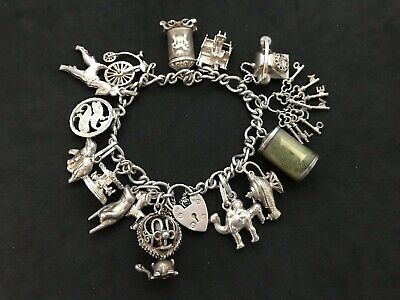 Vintage Sterling Silver Charm Bracelet with 16 Silver Charms. 60 grams